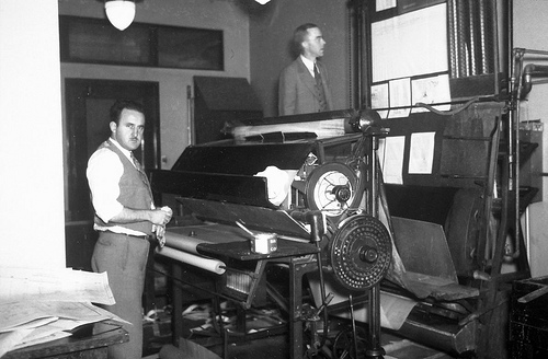 Men with printing press circa 1930s Image - Flickr/ Seattle Municipal Archives.